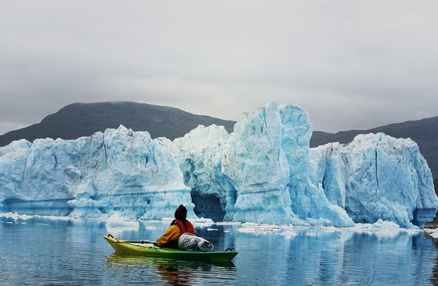 kayaking-in-greenland-near-glacier-gettyimages-693224942